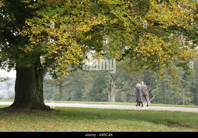 Manchester England UK Heaton Park couple walking - Stock Image
