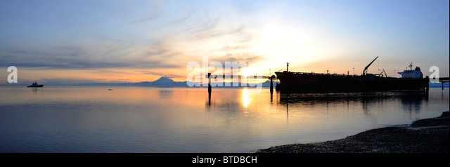 Sunset view of a Russian oil tanker off loading oil at the Kenai Tesoro refinery Kenai Peninsula, Alaska - Stock Image