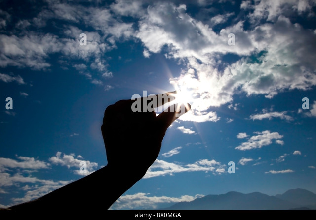 Sunlight like shine diamond, catched it by hand - Stock Image