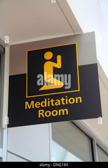 New Jersey Newark Newark Liberty International Airport EWR terminal concourse gate area sign meditation room - Stock Image