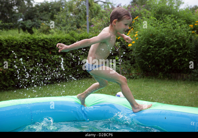 Childrens paddling pool stock photos childrens paddling for Best children s paddling pool
