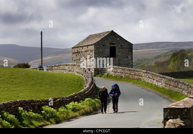 Coast to Coast walkers in Swaledale, 2012 on the route from Keld to Muker,  Richmondshire, North Dales Yorkshire - Stock Image