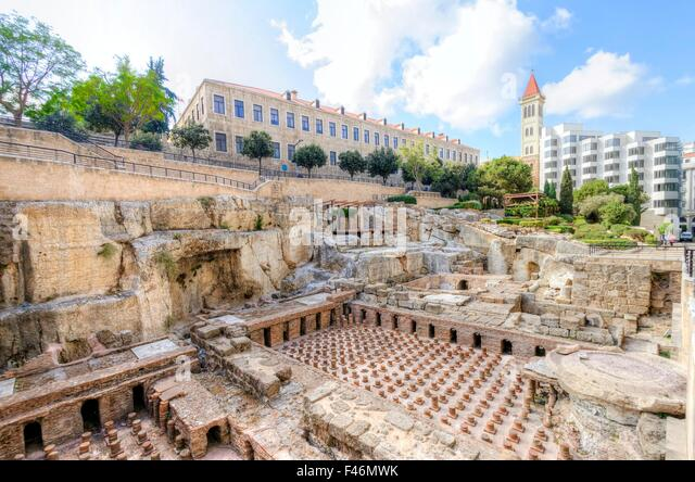 A view of the archaeological ruins of the ancient roman baths discovered in downtown Beirut, in Lebanon, surrounded - Stock Image