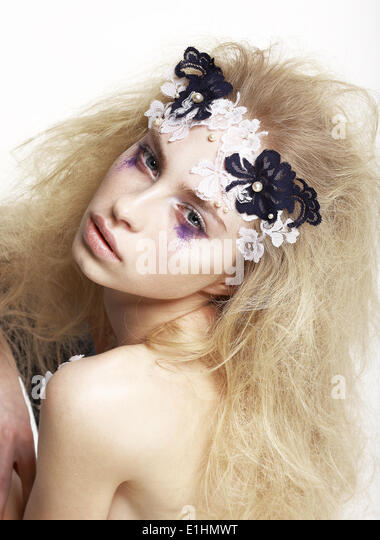 Emotional Caucasian Female with Bright Futuristic Mask and Make-up. Creative Faceart - Stock Image