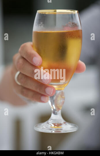 hand holding glass of beer. beverage, drink, alcohol, food. - Stock Image
