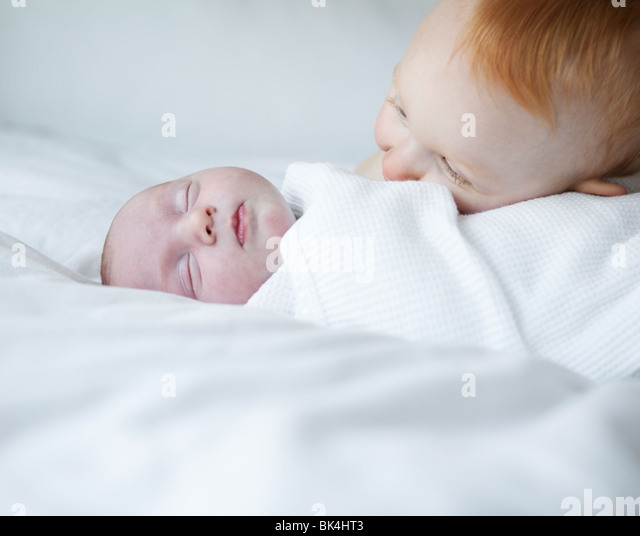 Red headed and sleeping baby - Stock Image
