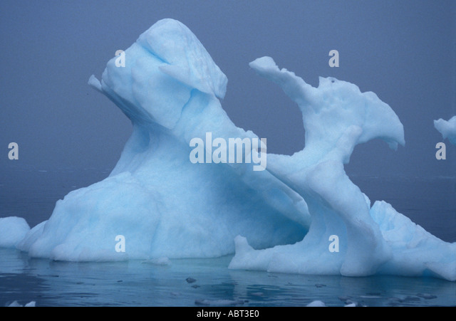 ANTARCTICA Iceberg in Heavy Fog Strange Unusual Shape Paradise Bay Antarctic peninsula - Stock Image