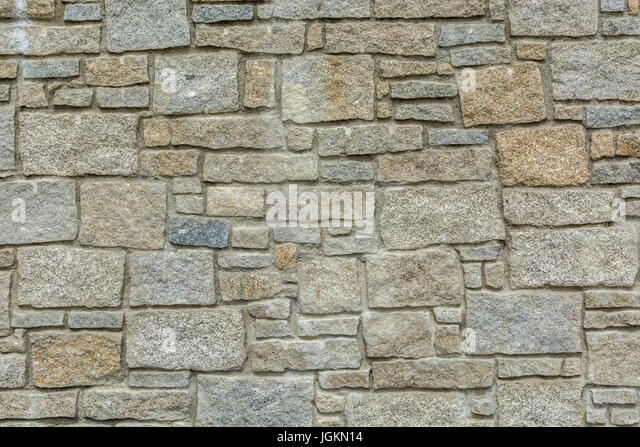 Granite stone wall in Cornwall - possible metaphor for concept of secure data / IT security and email blocked. - Stock Image