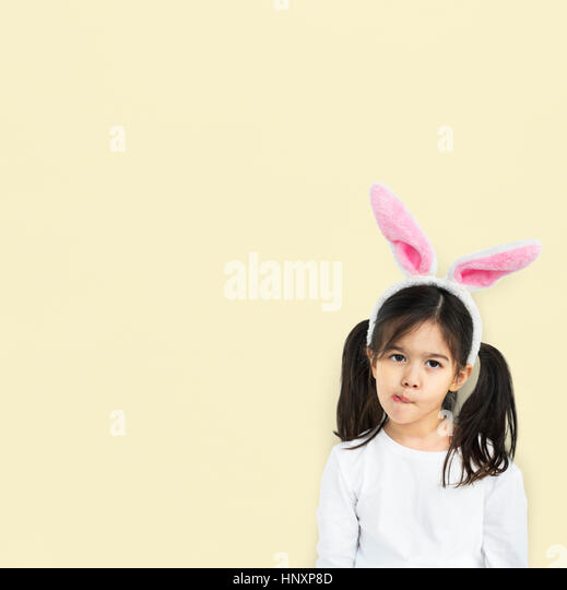 Little Girl With Bunny Ears Curious Studio - Stock Image