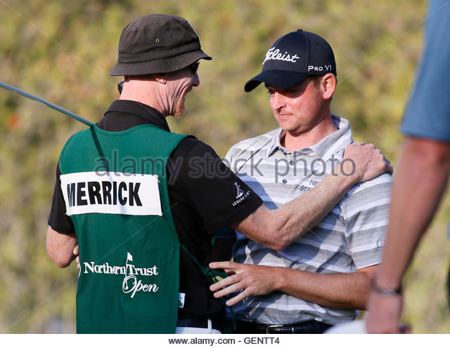 John Merrick (R) of the U.S. reacts with his caddie Ryan Goble as he celebrates winning the Northern Trust Open - Stock Image