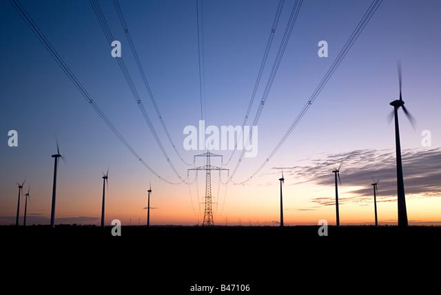 Pylon and wind turbines - Stock Image