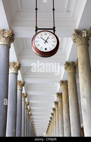 Round clock in a colonnade, Karlovy Vary - Stock-Bilder