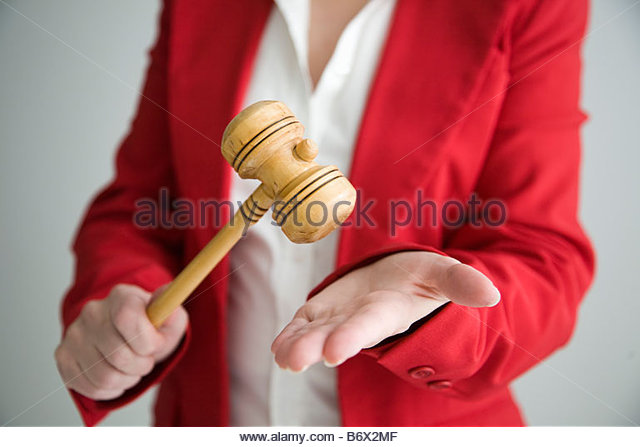 Woman with gavel - Stock Image