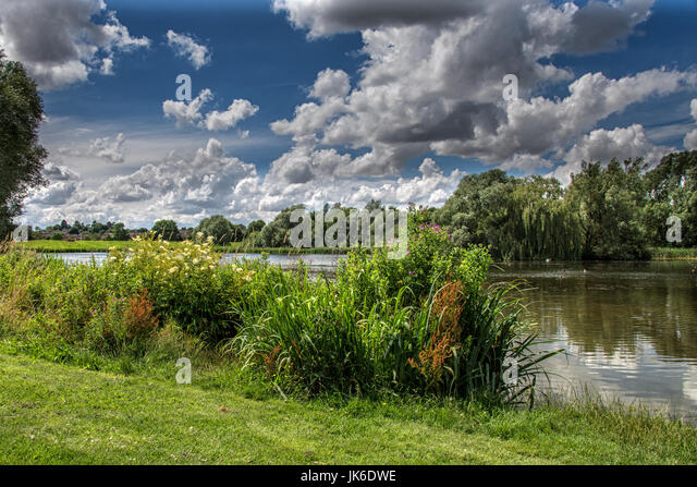 Melton Mowbray 22nd July 2017: Dark clouds  with a cool wind and down pours of rain, bad weather  not stopping this - Stock Image