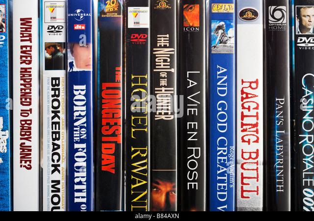 Row of spines of famous DVD films close up - Stock Image