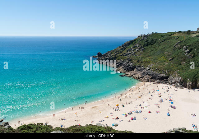 Porthcurno, Cornwall, UK. 17th July, 2016. UK Weather. Hot and sunny weather bring out the visitors to the beach - Stock Image