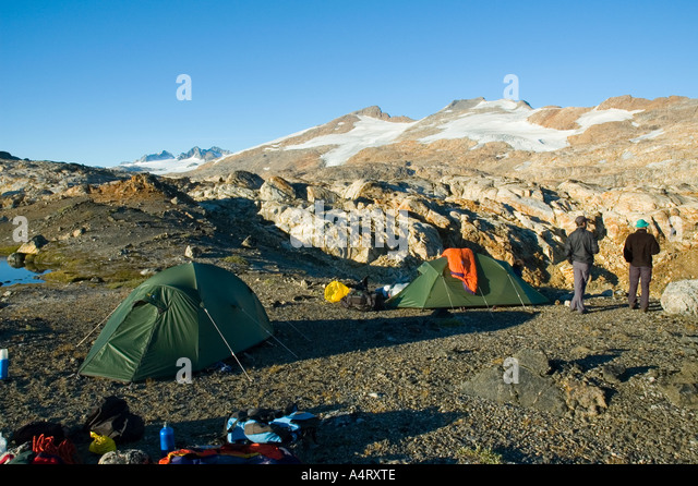 Trekkers camped in the mountains of Angmagssalik Island, Sermilik Fjord, East Greenland - Stock Image