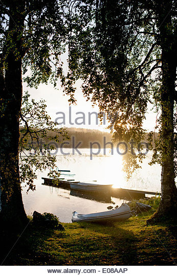 Tranquil view of boats at lakeshore - Stock Image