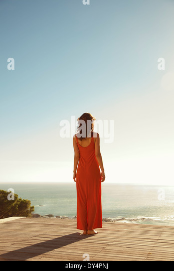 Back View of Woman Looking at the Ocean - Stock Image