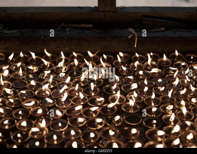 Candles at the Boudhanath Stupa - Stock Image