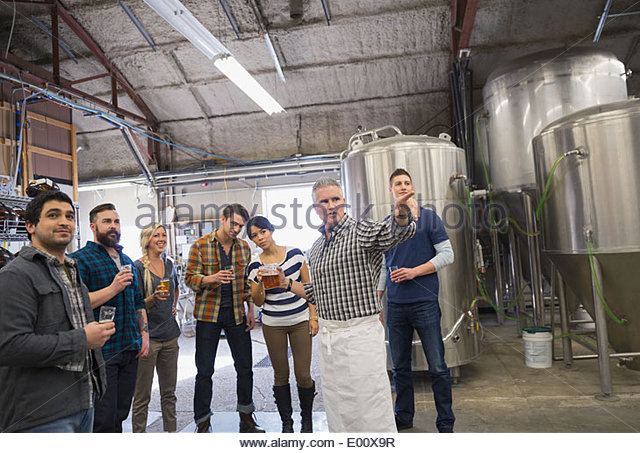 Man guiding tour at brewery - Stock Image