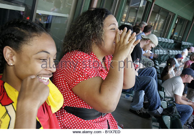 Arkansas North Little Rock Dickey Stephens Park minor league baseball Arkansas Travelers Black man woman stadium - Stock Image