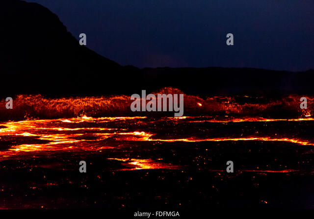 Bright red lines radiate from the most active point of Erta Ale's lava lake - Stock Image