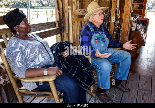 Gainesville Florida Dudley Farm State Park Homestead and Living History Museum property senior man explaining talking - Stock Image