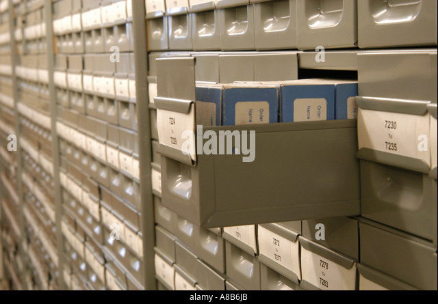 Microfiche library with a drawer open - Stock Image