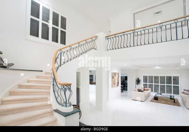 entrance hall in luxury modern mansion - Stock Image