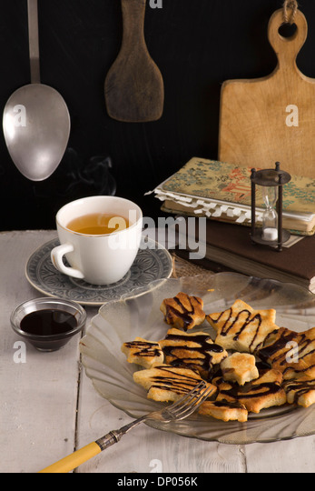 Coconut cookies in the kitchen. Recipe - Stock Image