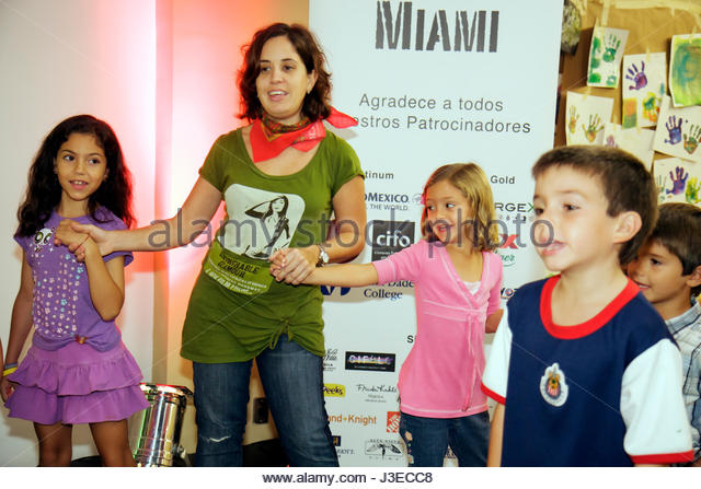 Miami Florida Miami Art Central Festival Mexico Miami Hispanic woman girls boys child children teach play event - Stock Image