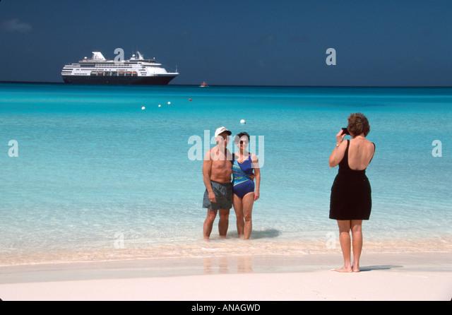 Bahamas Half Moon Cay Holland America Line ms Maasdam beach cruise ship passengers couple posing photo - Stock Image