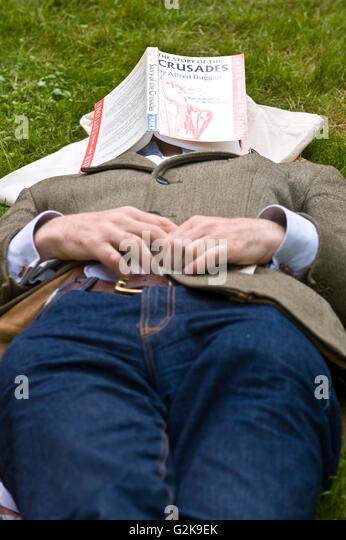 Visitors sleeping on the lawn at Hay Festival 2016 - Stock Image