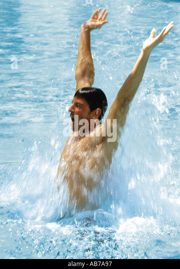 Man splashing water - Stock Image