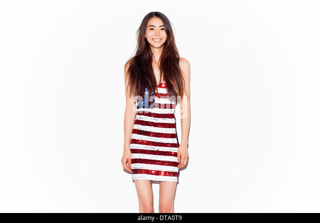 Young Woman Wearing American Flag Sequins Dress - Stock Image