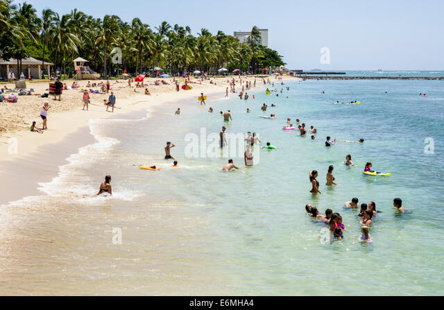 Hawaii Hawaiian Honolulu Waikiki Beach Sans Souci State Recreational Park Pacific Ocean swimmers bathers sunbathers - Stock Image