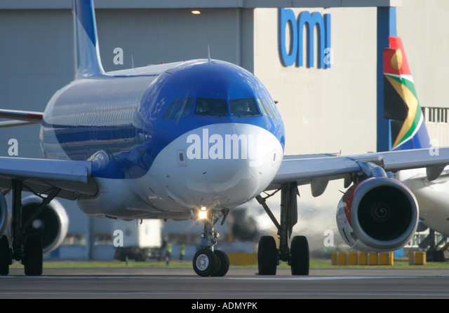 BMI airline aircraft and logo in the background - Stock Image