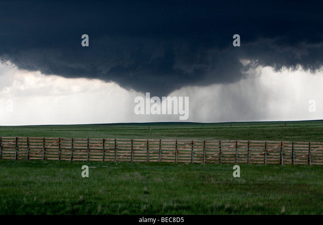 A funnel cloud lowers from the sky in Goshen County, Wyoming, USA, June 5, 2009. Shot during Project Vortex 2. - Stock Image