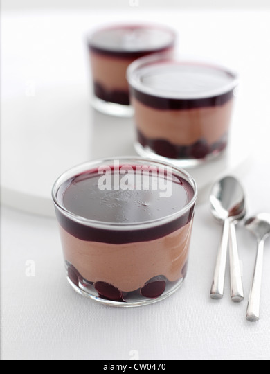 Dishes of cherry chocolate mousse - Stock Image