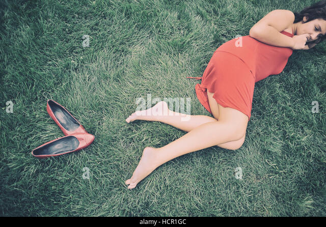 Girl lying on the grass - Stock Image