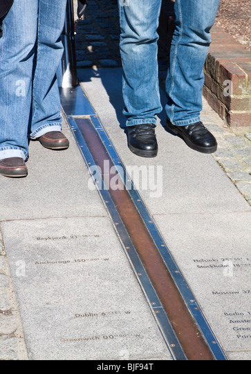 Tourists on the Greenwich Prime Meridian Line 0 Degrees Longitude - Stock Image