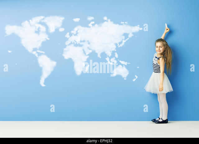 Little child drawing a world map - Stock Image