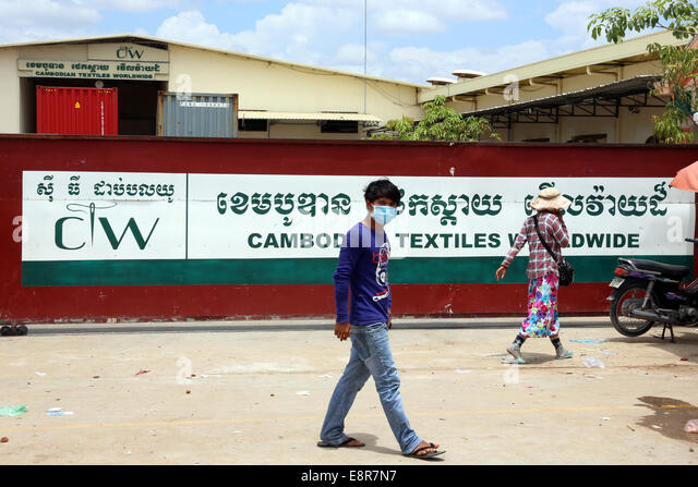 Gate to a chinese operated textile factory in the industrial area Pochentong in Phnom Penh, Cambodia, Asia - Stock Image