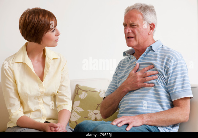Man having a heart attack. - Stock Image
