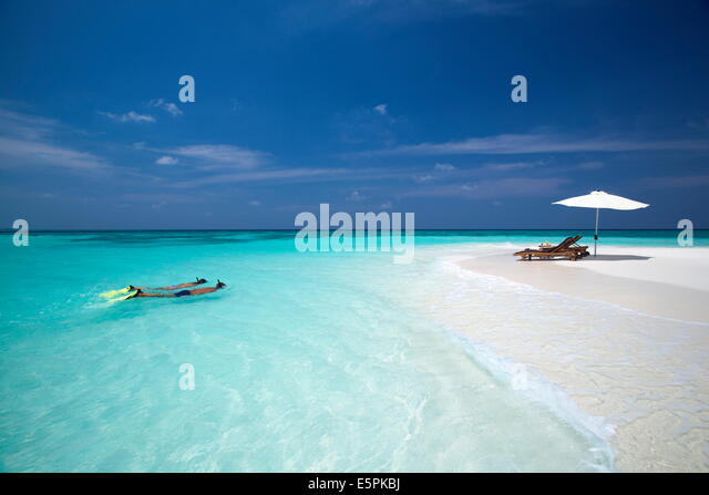 Couple snorkelling in Maldives, Indian Ocean, Asia - Stock Image
