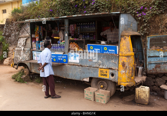 India, Kerala, Munnar Bazaar, food stall converted from old stationary van - Stock Image