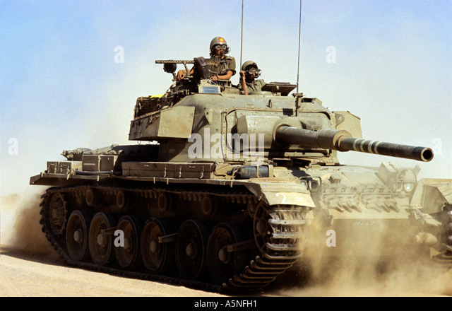 AN ISRAELI TANK MOVING INTO THE FRONT AFTER CROSSING THE SUEZ CANAL DURING THE 1973 WAR.PHOTO TERRY FINCHER - Stock Image