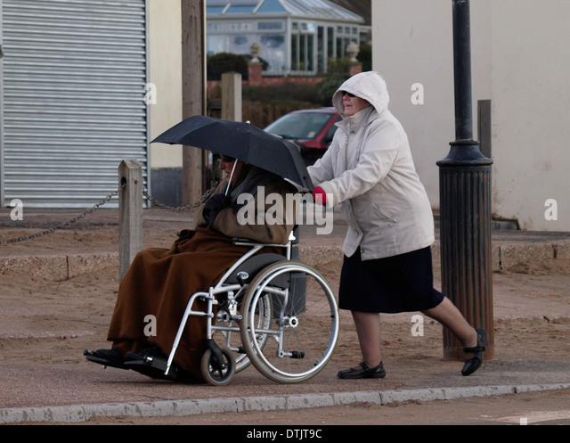 Pushing Wheelchair And Uk Stock Photos & Pushing