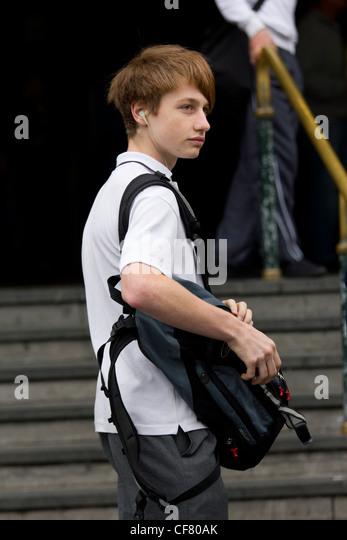 schoolboy with bag outside Flinders Street Station, Melbourne, Australia - Stock Image